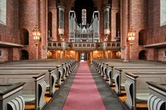 Lonely woman praying. The interior of the Swedish church, with a view of the church organ Royalty Free Stock Photography