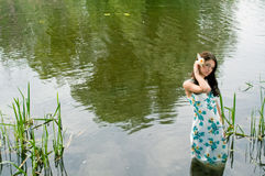 Lonely woman in river stock photos
