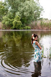 Lonely woman in river stock photo