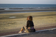 Lonely woman at seaside Stock Image