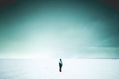 Lonely woman on the shore Stock Photos