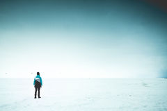 Lonely woman on the shore Royalty Free Stock Photo