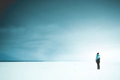 Lonely woman on the shore Stock Photography
