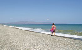Lonely woman on a shore royalty free stock photo