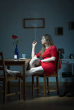 Lonely woman smoking cigarette Royalty Free Stock Images