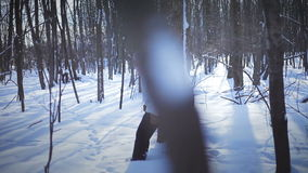 Lonely Woman Snowshoeing in nature stock footage