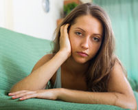 Lonely  woman on sofa Stock Images