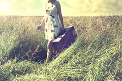 Lonely woman takes a trip to a different life. Woman takes a trip to a different life Royalty Free Stock Photography