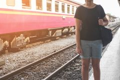 Lonely woman on train platform of railway station her feel homesick. royalty free stock images