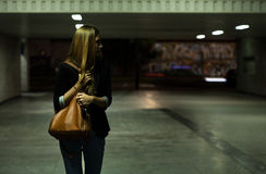 Lonely woman in the underpass. View of lonely woman in the underpass Royalty Free Stock Images
