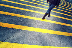Lonely woman walk on asphalt floor with yellow lines Royalty Free Stock Photography