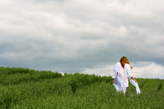Lonely woman walking outdoor Royalty Free Stock Photography
