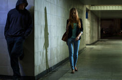 Lonely woman walking at night. View of lonely women walking at night royalty free stock photography