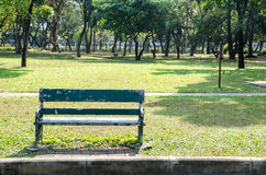 Lonely wooden bench in the park Royalty Free Stock Photography