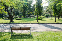 Lonely wooden bench in the park Stock Images