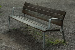 Lonely wooden bench in the park Royalty Free Stock Photo