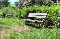 Lonely wooden benches a silent places taken all over northern europe. Lonely wooden benches a silent places taken all over northern germany royalty free stock image