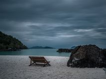 Lonely wooden boat on the beach after rain Royalty Free Stock Images