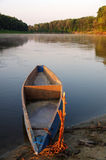 The lonely wooden boat on the river Stock Photos