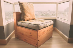 Lonely wooden chair in a condo. Lonely wooden chair in a condo room Stock Photo