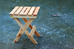 Lonely wooden folding stool Royalty Free Stock Photography