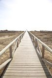Lonely wooden footbridge Royalty Free Stock Images