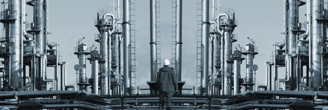 Lonely worker in fron of giant refinery panoramic Royalty Free Stock Photography