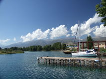 Lonely yacht. The photo is made at a mooring of lake Issyk-kul royalty free stock photos