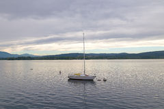 Lonely yacht on Lake Como in Northern Italy. Royalty Free Stock Photo