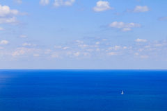 Lonely yacht in the Mediterranean Sea, the bird's-eye view.  Stock Photos