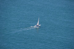 Lonely yacht in the ocean Stock Photography