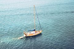 Lonely yacht in the ocean. fishing boat in the sea Stock Photo