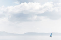 Lonely yacht sailing on a calm sea Royalty Free Stock Images