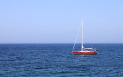 Lonely yacht in sea in summer in southern resort Royalty Free Stock Image