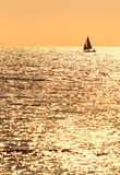 Lonely yacht at sunset background Royalty Free Stock Image