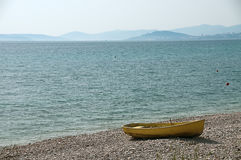 Lonely yellow boat at the seaside Royalty Free Stock Image