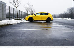 A Lonely Yellow Car. In a bit Industrial Parking royalty free stock images