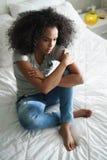 Depressed Hispanic Girl With Sad Emotions And Feelings Stock Photos