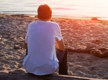 Sad Young Man. Lonely Young Man on the Nature at Sunset Royalty Free Stock Photos