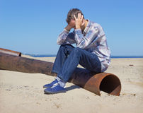 Lonely young man suffering from depression Stock Photo