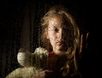 Free Lonely Young Sad Girl Behind The Window With Drops, Holding Teddy Bear And Crying Royalty Free Stock Images - 78259779