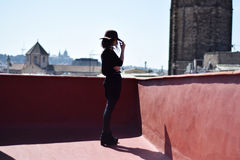 Lonely young woman in brown hat from the back thinking on terraсe, Barcelona Royalty Free Stock Images