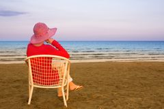 Lonely young woman near the ocean Stock Image