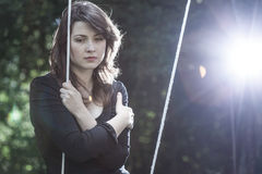 Lonely young woman in sorrow. Sitting on the swing stock images