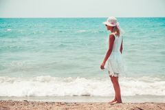 Lonely young woman walking on the beach.  royalty free stock photo