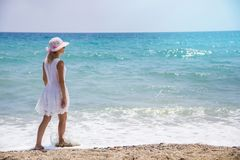 Lonely young woman walking on the beach.  royalty free stock photography