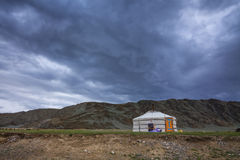 Lonely yurt at the foot of the mountains Royalty Free Stock Images