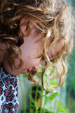 Lonelyness. Little girl looking into window, sad Royalty Free Stock Images