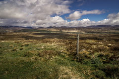 Lonelyness in Scotland. Scottish landscape with clouds in a blue sky Royalty Free Stock Photography