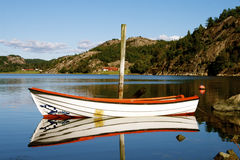 Lonesome Boat. Boat that has been left om a lake stock photography